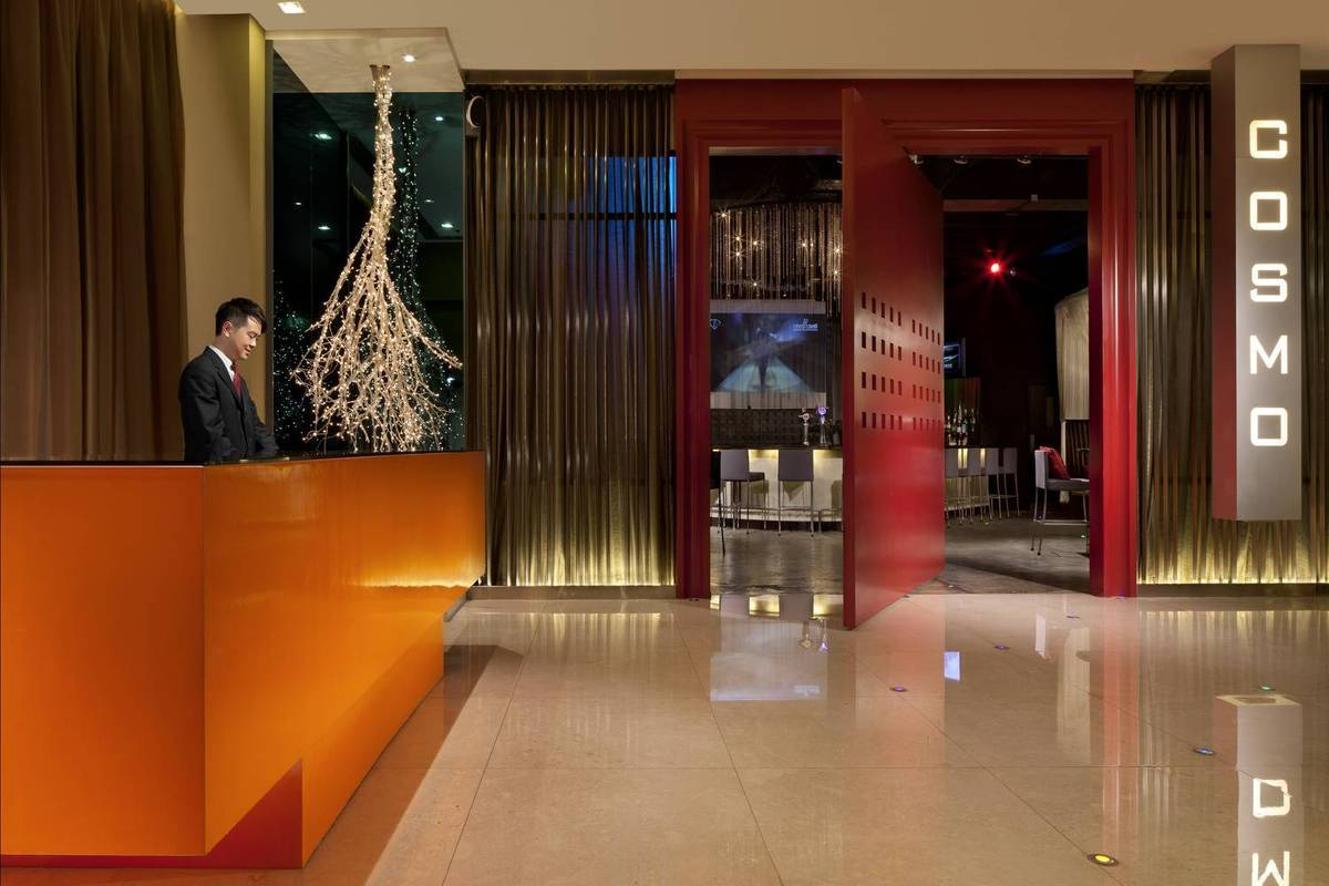 Hotel Reception - A splash of orange sets the tone in our lo