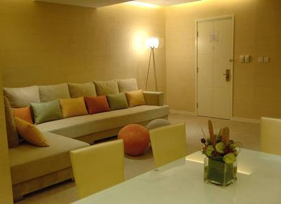 The Yellow Two-bedroom Suite - Sitting Room - A comfy extended sofa emphasises the ultimate in lounging comfort